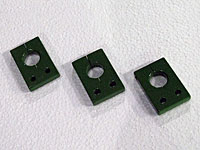 Three small green painted parts.